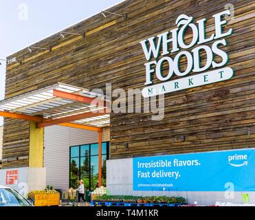 April 14, 2019 San Jose / CA / USA - Whole Foods store displaying an ad for Amazon Prime Membership - Stock Photo