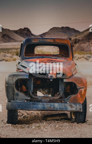 Old, red car in Rhyolite, Death Valley, California, USA - Stock Photo