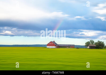 Traditional colored wooden house in Norway - Stock Photo