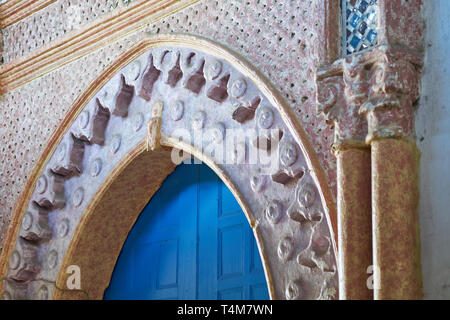 Closeup of a beautiful moroccan house entrance with blue door and decorated moorish arch in the medina (kasbah area) of Tangier (Tanger), Morocco - Stock Photo