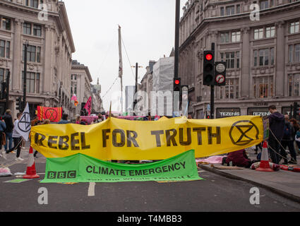 17th April 2019: Extinction Rebellion: Protesters Banner ' Rebel for Truth ' in Oxford Circus. London. UK - Stock Photo