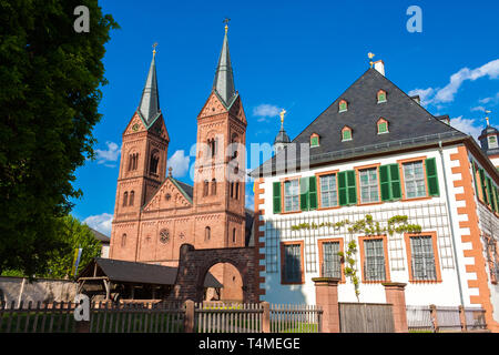 Seligenstadt's famous landmark, the Einhard-Basilika (Basilika St. Marcellinus & Petrus) with its two Romanesque Revival towers next to the former... - Stock Photo