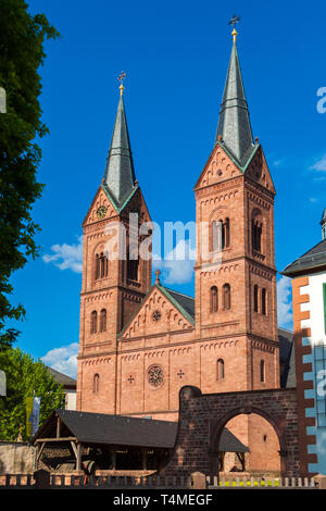 Perfect portrait view of the two Romanesque Revival towers at the west façade of the historic Basilika St. Marcellinus und Petrus, also known as... - Stock Photo