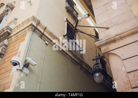 Two CCTV cameras on the cone of the morden building. - Stock Photo
