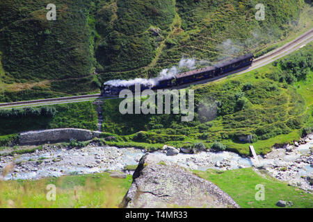 Steam train in the green valley - Stock Photo
