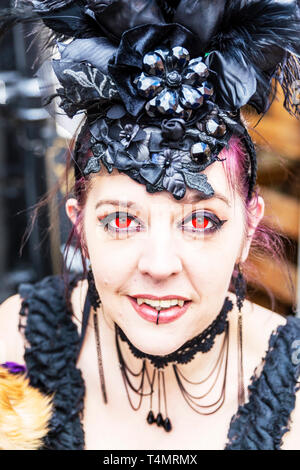 Whitby Goth Weekend 2019, Whitby Goths, Whitby Goth, goth, goths, gothic costume, Whitby, Yorkshire, UK, Goth characters, goth costume, Red eyes - Stock Photo