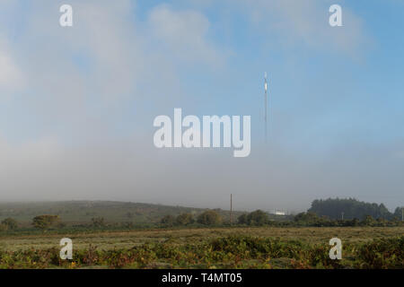 Caradon Hill tv mast coming out the fog. - Stock Photo