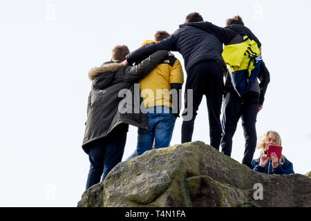 Teenagers taking a group photo on a mobile phone in the countryside, UK - Stock Photo
