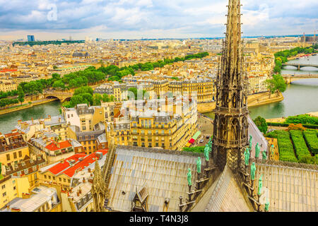 Close up aerial view on the spire of Notre Dame cathedral with statues, in Paris city capital of France. From top of the gothic church Our Lady of - Stock Photo