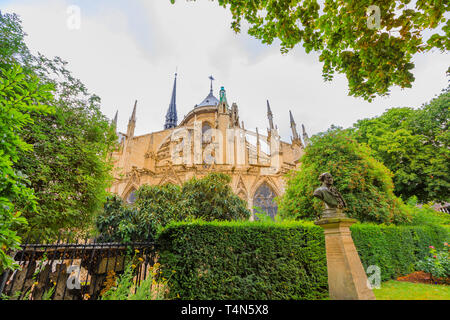 backside garden of Notre Dame de Paris, popular landmark and cathedral of the capital city of France. Gothic French architecture of Our Lady of Paris - Stock Photo