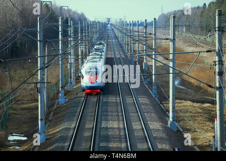 ULYANOVKA, RUSSIA - APRIL 10, 2018: Approaching modern high-speed train Sapsan EVS2-04. View from above - Stock Photo