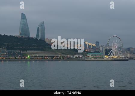 View of the city embankment in January twilight. Baku, Azerbaijan - Stock Photo