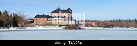 Panorama of lake Vanajavesi with its old fortress on a sunny March day. Hameenlinna, Finland - Stock Photo