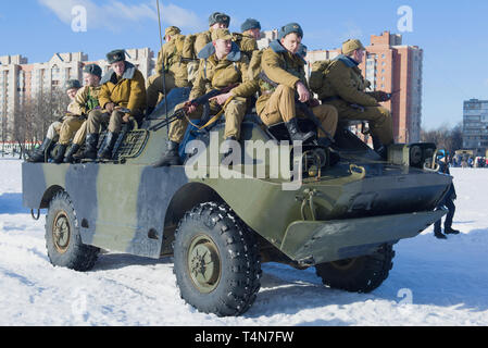 SAINT-PETERSBURG, RUSSIA - FEBRUARY 17, 2019: Soviet soldiers on a BRDM-2 armored car. Fragment of the military-historical festival in honor of the th - Stock Photo