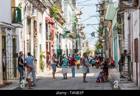 Havana, Cuba - 25 July 2018: Cuban people congregating and talking with each other in the street going about their daily life. - Stock Photo