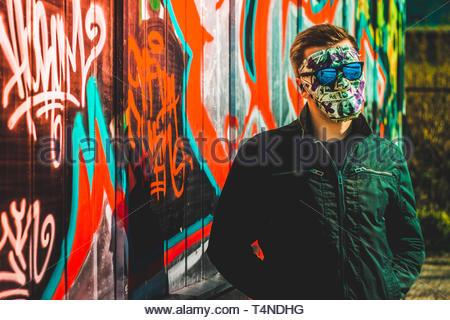 man wearing black jacket - Stock Photo
