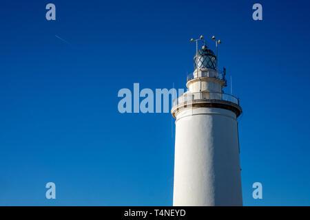 Lighthouse La Farola de Malaga in Malaga city. Andalusia, Costa del sol, Spain - Stock Photo