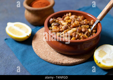Prebranac Balkan baked beans. Serbian, Montenegrin, Bosnian, Croatian, Slovenian cuisine. Baked  beans, lemon, paprika powder.  Close-up - Stock Photo