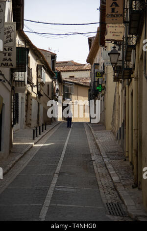 Chinchon, Spain - 04 14 2019: Narrow uphill street of this picturesque small village - Stock Photo