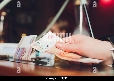 Russian rubles in the hand of a fan.male hand holding many of the Russian banknotes.The transfer of money.The isolated five-thousandth of Russian - Stock Photo