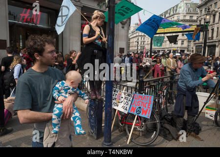 Activists with Extinction Rebellion protest about climate change in a blocked-off Oxford Circus, on 17th April 2019, in London, England. - Stock Photo