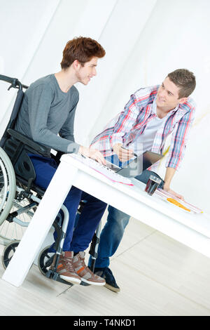 disabled student studying and preparing for college exams - Stock Photo
