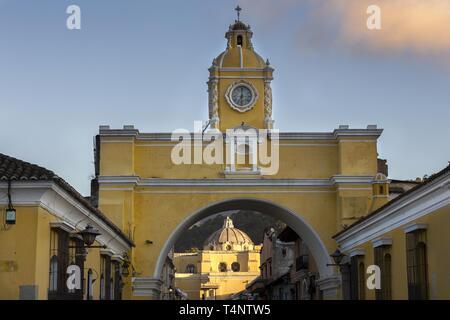 Spanish Colonial Architecture in Old City Antigua Guatemala with Santa Catalina Arch and Catholic Church Iglesia de la Merced in the Background - Stock Photo
