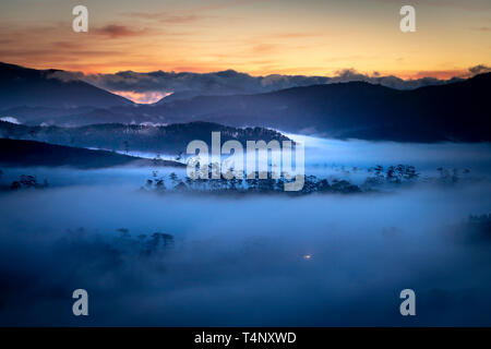 Beautiful images of the radiant dawn with reflecting rays through the fanciful clouds on over the pine forests, which created an impressive breathtaki - Stock Photo