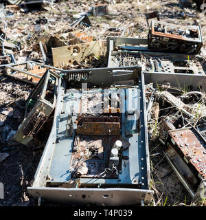 Abandoned circuit boards and computer components at the site of the Duga-1 array within the Chernobyl Exclusion Zone, Ukraine. The Duga radar was a so - Stock Photo