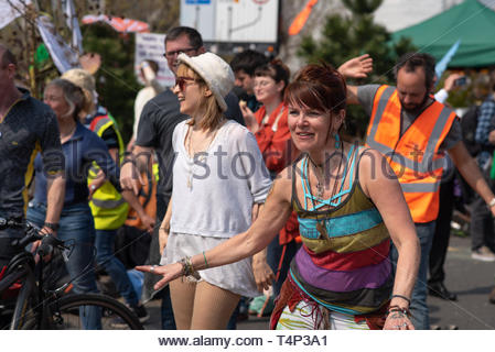 London, UK. 17th Apr, 2019.  A female protestor dances on Waterloo bridge what has been closed for three days due to extinction rebellion protest. - Stock Photo