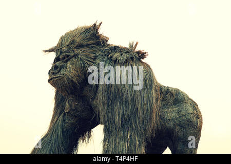 Straw handmade crafting as a model of a Gorilla display at river side during Lao New Year - Stock Photo