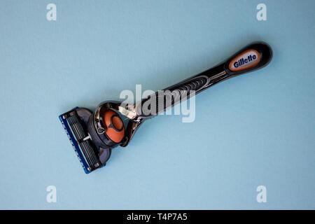 LONDON - APRIL 14, 2019: Gillette razor blade on blue background - Stock Photo
