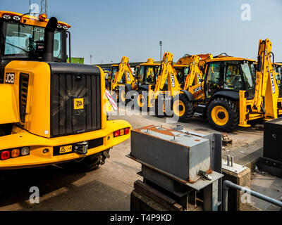 British Exports - JCB diggers or backhoe loaders  ready for export at the port of Harwich in Eastern England. - Stock Photo