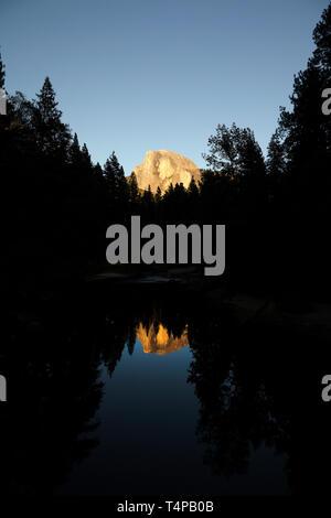 Half Dome reflected in Merced River, Yosemite National Park, California, America. - Stock Photo