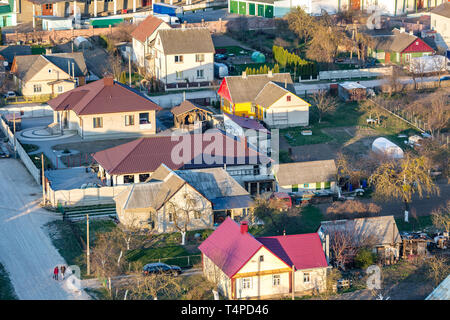 Panoramic view on village building area urban development residential quarter in the evening from a bird's eye view - Stock Photo