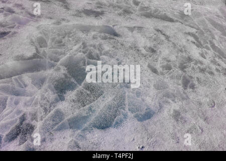 Texture of melted ice on the lake in spring. - Stock Photo