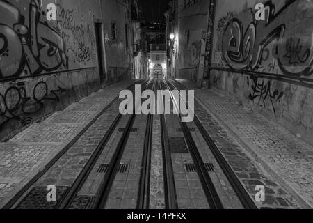 Elevador da Bica cable car rails on Rua de Bica de Duarte Belo, Barrio Alto district. - Stock Photo