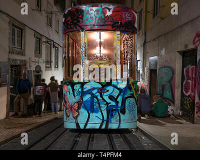 A graffitied cable car (Elevador da Bica) on Rua de Bica de Duarte Belo, Barrio Alto district. Veiw from Lagro Calhariz. - Stock Photo