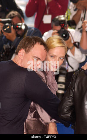 CANNES, FRANCE. May 16, 2004: QUENTIN TARANTINO & UMA THURMAN at the photocall at the Cannes Film Festival for Kill Bill Volume 2 which is screening out-of-competition. - Stock Photo