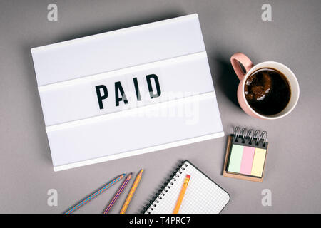 Paid. Text in light box - Stock Photo