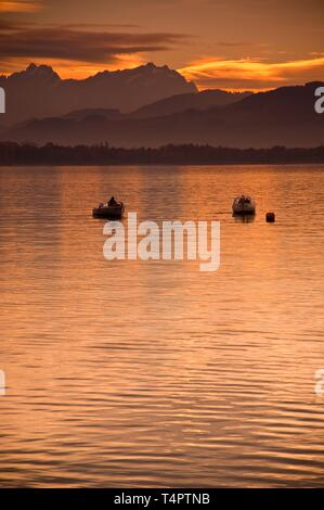Fishing boats on Lake Constance, overlooking the Säntis massif in Switzerland, Germany, Europe - Stock Photo