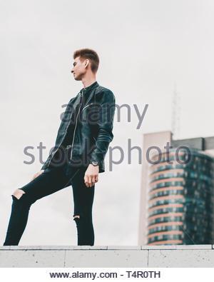 man in black leather zip jacket - Stock Photo