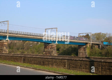 Two car Pacer diesel multiple unit train in Northern livery crossing Carlisle Bridge over the River Lune in Lancaster with local train 17th April 2019. - Stock Photo