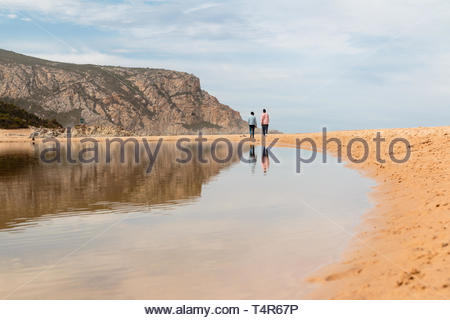 couple walking in sand - Stock Photo