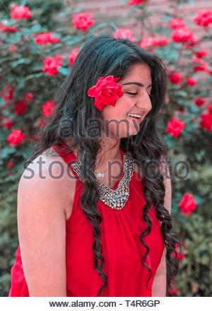 flower in ladies hair - Stock Photo
