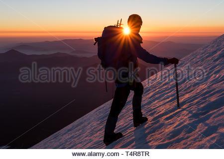 a man climbing ice hill - Stock Photo