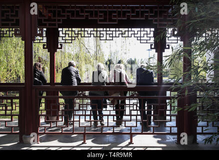 Berlin, Germany. 17th Apr, 2019. Visitors are seen at the Deyue Chinese Garden of the Gardens of the World in eastern Berlin, Germany, on April 17, 2019. The Deyue Chinese Garden inside the Gardens of the World was first built in 1997 and opened to the public in 2000. Credit: Shan Yuqi/Xinhua/Alamy Live News - Stock Photo