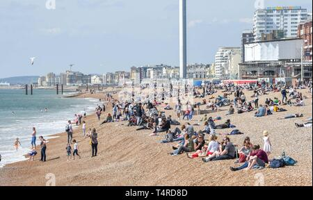 Brighton, UK. 18th Apr, 2019. Brighton beach and seafront are packed as visitors start to enjoy the hot sunny weather with it forecast to continue over the Easter weekend with temperatures expected to reach over twenty degrees in some parts of the South East Credit: Simon Dack/Alamy Live News - Stock Photo