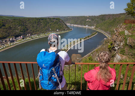 St.Goarshausen, Germany. 18th Apr, 2019. Tourists are standing on the Loreley rock after the opening of the landscape park. The redesign began in September 2016. The federal government, the state and the Loreley municipality have provisionally provided around 15.5 million euros for the redesign and renovation of the leased concert stage. Credit: Thomas Frey/dpa/Alamy Live News - Stock Photo