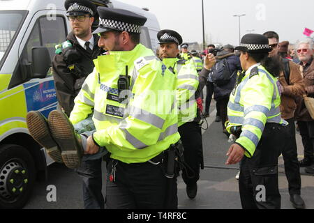 London, City of London, UK. 17th Apr, 2019. A protester is seen carried away by police from the Waterloo Bridge during the demonstration.Protesters blocked roads demanding for the Government to take action on climate change issues during the Extinction Rebellion disruption and protests in Central London. Credit: Ben Booth/SOPA Images/ZUMA Wire/Alamy Live News - Stock Photo